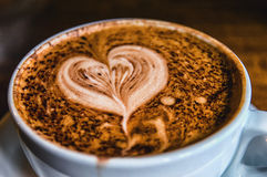 Heart Coffee. Latte art, coffee on the wooden desk as background Royalty Free Stock Photography