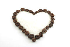 Heart of coffee with sugar inside Stock Photos