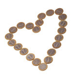 Heart of coins. Heart shape created from coins isolated on white with clipping path Stock Images