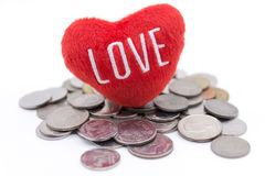 Heart and coins on white background Royalty Free Stock Image