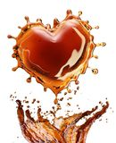 Heart from cola splash with bubbles isolated on white royalty free stock photography