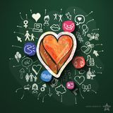 Heart collage with icons on blackboard Stock Images