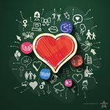 Heart collage with icons on blackboard Royalty Free Stock Photo