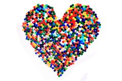 Heart from color plastic caps Stock Image