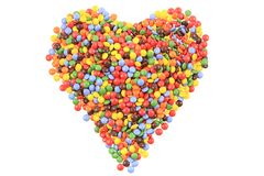 Heart from color smarties isolated. On the white background Stock Photos