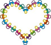 Heart of colored baby soothers Stock Images