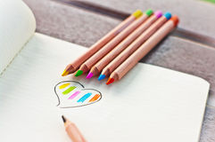 Heart colored, colored pencils 1. Colorful heart from colored pencils on notebook page Stock Photos