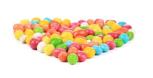 Heart of colorful candies dragee Royalty Free Stock Photography