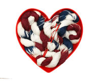 Heart with colorful knitting yarn Stock Photo
