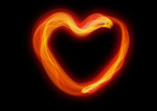 The heart of combustion. Red combustion of heart, under the background of the dark color Royalty Free Stock Photo