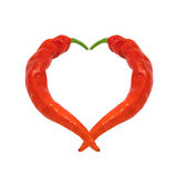 Heart composed of red chili peppers Stock Photos