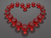 Heart composed from red glass balls Royalty Free Stock Photos
