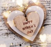 Heart composition for Valentine`s, Mother`s or Women`s Day. Wooden hearts on old white desk. Royalty Free Stock Image