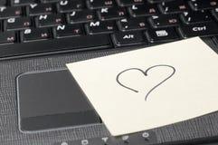 Heart on computer keyboard Stock Image