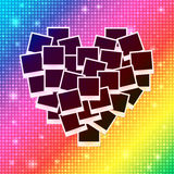 Heart concept made with empty photos on shining rainbow background Royalty Free Stock Photography
