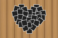 Heart concept made with photo frames on brown wooden texture. Memories, card, love template design stock illustration