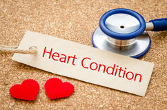 Heart condition words and stethoscope. Royalty Free Stock Images
