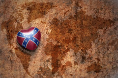 Heart with  confederate flag  on a vintage world map crack paper background. Heart with confederate flag  on a vintage world map crack paper background. concept Stock Photography