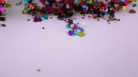 Heart confetti blows away. Video of heart confetti blows away stock video