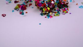 Heart confetti blows away. Video of heart confetti blows away stock video footage