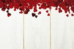 Heart confetti border on white wood Stock Image