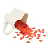 Heart confetti falling out of the cup Royalty Free Stock Images