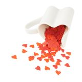 Heart confetti falling out of the cup Stock Image