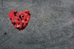 Heart from confetti Stock Photos
