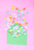 Heart confetti on pink Stock Images