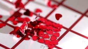Heart confetti scattering on calendar. In slow motion stock video footage