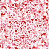 Heart confetti seamless pattern for Valentines day, falling on white background. Pink and red symbols of love for Women Stock Image