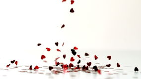 Heart confettis falling down Royalty Free Stock Images