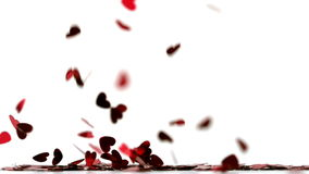 Heart confettis falling on the floor Royalty Free Stock Photography