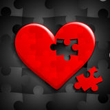 Heart consisting of puzzles Stock Images