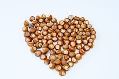 Heart consists of hazelnuts isolated Royalty Free Stock Photos