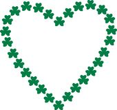 Heart contour of green shamrocks. Vector Royalty Free Stock Images