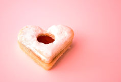 Heart Cookie. Heart shaped cookie on read toned background royalty free stock images