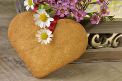 Heart cookie and flowers Royalty Free Stock Photos
