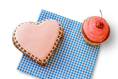 Heart cookie and pink cupcake. Royalty Free Stock Photography