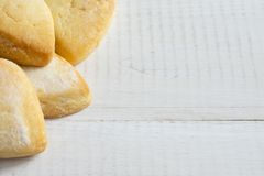 Heart of the cookie and wooden background. Stock Images