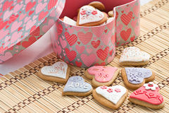 Heart Cookies. Handmade cookies in box with pink heart pattern on a bamboo pad stock photos