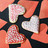 Heart cookies baked Valentine's Day and hearts cut from paper Royalty Free Stock Photography