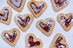 Heart cookies on baking paper Stock Images