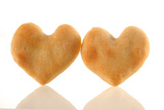 Heart cookies couple with reflection. Royalty Free Stock Image