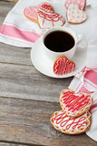 Heart cookies with cup of coffee on the grey wooden background Stock Photography