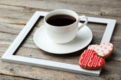 Heart cookies with cup of coffee on a grey wooden background Royalty Free Stock Images
