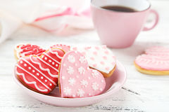 Heart cookies with cup of coffee on the white wooden background Royalty Free Stock Images