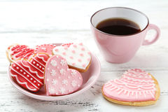 Heart cookies with cup of coffee on the white wooden background Royalty Free Stock Photos