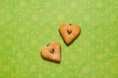 Heart Cookies on green background. Two chocolate heart-shaped cookies on green background Royalty Free Stock Photos