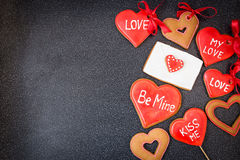 Heart cookies with letter on dark background Stock Photo